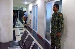Security forces situated outside the office of Maldives Marketing and Public Relations Corporation following the uncovering of the scandal and the investigation that led afterwards. PHOTO: MIHAARU FILE PHOTOS