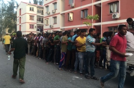 Expatriates queue for Iftar near a mosque in Hulhumale', during the Muslim fasting month of Ramadan. PHOTO: MIHAARU FILES