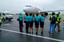 Cabin crew members pictured in front of a Maldivian aircraft. PHOTO/MIHAARU