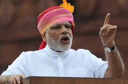 Indian Prime Minister Narendra Modi gestures as he delivers his Independence Day speech from The Red Fort in New Delhi on August 15, 2016. / AFP PHOTO / PRAKASH SINGH