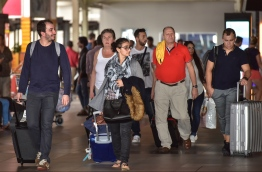 A group of tourists arrives at Velana International Airport. PHOTO: NISHAN ALI / MIHAARU