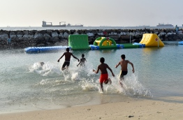 Children pictured playing at Rasfannu Beach in Male' City. PHOTO/MIHAARU