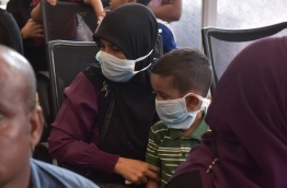 People wear surgical masks in the temporary flu clinic opened in IGMH amidst the swine flu outbreak in Male in March 2017.