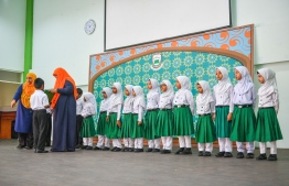 Students of Arabiyya School receiving their report forms on the last day of school. PHOTO: HUSSAIN WAHEED / MIHAARU