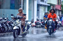 Capital city Male' experiencing heavy rain with flooding in several areas. PHOTO: MIHAARU.