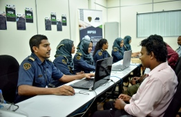 People pictured at Maldives Immigration service counters. FILE PHOTO/MIHAARU