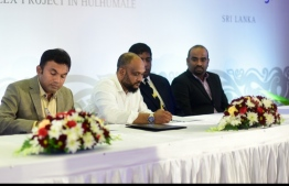 Ahmed Moosa Mohamed (L-2), the Managing Director of SeaLife Global, signs the Hulhumale housing project agreement. FILE PHOTO/MIHAARU