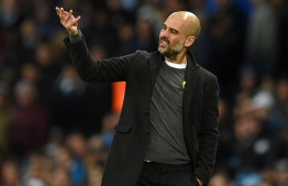 Manchester City's Spanish manager Pep Guardiola gestures on the touchline during the UEFA Champions League round of sixteen second leg football match between Manchester City and Basel at the Etihad Stadium in Manchester, north west England, on March 7, 2018. / AFP PHOTO / Oli SCARFF