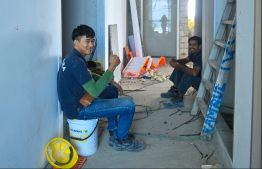 MALE: Two workers at the construction site of Dharumavantha School taking a break. PHOTO: HUSSAIN WAHEED/MIHAARU
