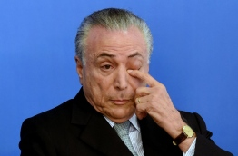 With Dilma Rousseff accusing him of having engineered a coup, Brazil's acting president Michel Temer faces bitter opponents on the left. In the latest incident, riot police were sent to clear out protesters near his home in Sao Paulo and also at a presidential office in the city.