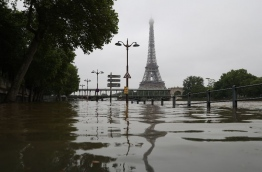 The river Seine bursting its banks next to the Eiffel Tower in Paris on June 2, 2016