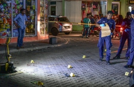 Police cordon off the area where a 14 year old was fatally stabbed in the capital Male. MIHAARU PHOTO/MOHAMED SHARUHAAN