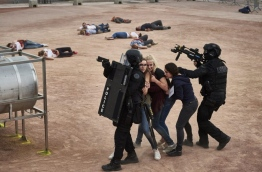 Police forces take part in a mock suicide attack exercise as part of security measures for the upcoming Euro 2016 football championship, at the fan zone in Lyon, central-eastern France, on June 7, 2016. / AFP PHOTO
