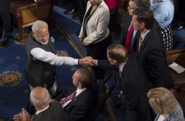 Indian Prime Minister Narendra Modi greets members of Congress prior to addressing a joint session of Congress on Capitol Hill on June 8, 2016, in Washington, DC. / AFP PHOTO