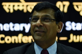 In this photograph taken on June 7, 2016, India's central bank - Reserve Bank of India (RBI) governor Raghuram Rajan reacts during a press conference following a monetary policy review meeting in Mumbai./ AFP PHOTO