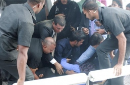 Security officers tend to the wounded after an IED detonated aboard the presidential speedboat in September last year. PHOTO/PRESIDENT'S OFFICE