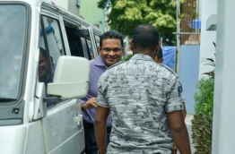 Former defence minister Mohamed Nazim smiles as he is led inside the Supreme Court for the hearing on June 15, 2016. MIHAARU PHOTO/NISHAN ALI