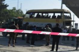 "A suicide bomber hit a minibus carrying foreign security guards and caused several casualties early on June 20 in Kabul along the main road to the eastern city of Jalalabad, police said. The attacker was on foot, according to police, who refused to give a toll but said there were ""multiple casualties"" among the bus passengers who were ""employees of a foreign compound"".The bus was carrying Nepalese guards, according to an AFP cameraman, who also reported more than two dozen ambulances at the scene. / AFP PHOTO / SHAH MARAI"