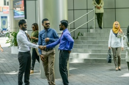 Some civil servants pictured outside the main government office building 'Velaanaage' in the capital Male. MIHAARU PHOTO/NISHAN ALI