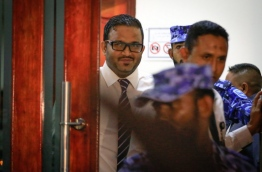 Former vice president Adheeb being escorted out of the criminal court after he was convicted and sentenced to 15 years in prison for orchestrating the blast aboard the presidential speedboat now confirmed as a plot to assassinate the president. MIHAARU PHOTO/MOHAMED SHARUHAAN