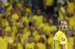 Sweden's forward Zlatan Ibrahimovic looks on during the Euro 2016 group E football match between Sweden and Belgium at the Allianz Riviera stadium in Nice on June 22, 2016. / AFP PHOTO / JONATHAN NACKSTRAND