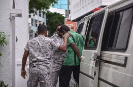 Hussain Humam convicted of killing MP Dr Afrasheem Ali being led to the Supreme Court on June 20, 2016. MIHAARU PHOTO/MOHAMED SHARUHAAN