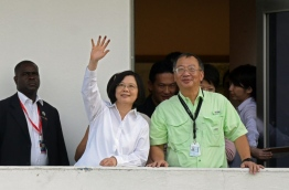 Taiwan President Tsai Ing-wen (C) waves to the press during her visit to the Miraflores section of the Panama Canal on June 25,2016 in Panama City.Panama will officially open its canal on Sunday to far bigger cargo ships after nearly a decade of expansion work aimed at boosting transit revenues and global trade. On Sunday, a VIP ceremony will be held on the banks of the canal to inaugurate the completion of the works. / AFP PHOTO / JOHAN ORDONEZ