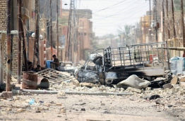 Destruction is seen in Fallujah, 50 kilometres (30 miles) from the Iraqi capital Baghdad, after Iraqi forces retook the embattled city from the Islamic State group on June 26, 2016.Iraqi Prime Minister Haider al-Abadi urged all Iraqis to celebrate the recapture of Fallujah by the security forces and vowed the national flag would be raised in Mosul soon. While the battle has been won, Iraq still faces a major humanitarian crisis in its aftermath, with tens of thousands of people who fled the fighting desperately in need of assistance in the searing summer heat./ AFP PHOTO / HAIDAR MOHAMMED ALI