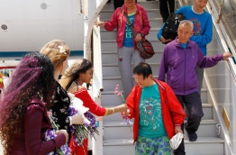 Some tourists greeted at the Ibrahim Nasir International Airport.