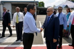 Former president Gayoom (R) greets his half brother and incumbent president Yameen. PHOTO/PRESIDENT'S OFFICE