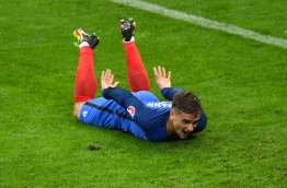 France's forward Antoine Griezmann celebrates after scoring his team's fourth goal during the Euro 2016 quarter-final football match between France and Iceland at the Stade de France in Saint-Denis, near Paris, on July 3, 2016. Francisco LEONG / AFP