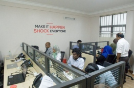 Reporters pictured at work in Mihaaru newsroom. MIHAARU FILE PHOTO