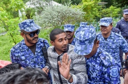 Police block an opposition lawmaker from holding a press conference in a restricted area. MIHAARU FILE PHOTO