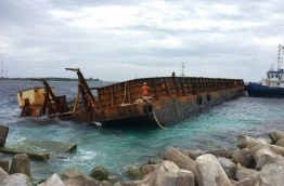 The barge had begun to keel following the breach and was unloaded at the Industrial Village with an excavator on Tuesday.