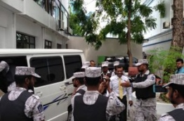 Jailed former president Nasheed being escorted by correctional service officer. PHOTO/AHMED AZIM