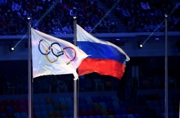 Russia operated a state-dictated doping system during the 2014 Sochi Winter Olympics and other events, an independent investigator said today in a report likely to lead to demands for Russia to be completely banned from the Rio Games. / AFP PHOTO / ANDREJ ISAKOVIC