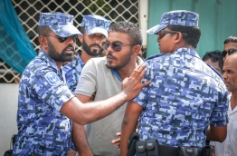 Police control protesters gathered near the criminal court for the sentencing of a top opposition lawmaker on Monday. MIHAARU PHOTO/MOHAMED SHARUHAAN