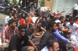 Some local journalists pictured during a sit-down protest in capital male calling on the government to ensure media freedom in the Maldives. FILE PHOTO