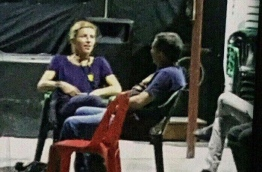One of the two foreign journalists pictured inside the MDP camp, moments before her arrest on Tuesday.