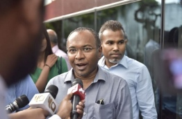 Hassan Latheef speaking to reporters after giving his statement to the police on Saturday. MIHAARU PHOTO/MOHAMED SHARUHAAN