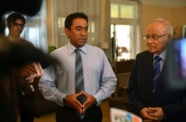 President Yameen (L) speaks to the media as his half brother and ruling party president Maumoon Abdul Gayoom looks on.