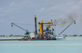 A dredger reclaims land for Maldives main airport's new runway. MIHAARU PHOTO/MOHAMED SHARUHAAN