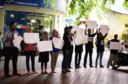 Local journalists protest against the government move to criminalise defamation near the parliament on Monday. MIHAARU PHOTO/HUSSAIN SHAYAAH