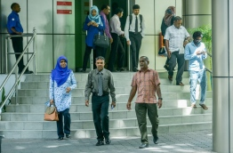 People pictured at the entrance to the main government office complex 'Velaanaage'. MIHAARU FILE PHOTO/NISHAN ALI
