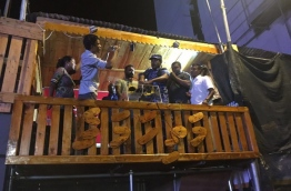 A police officer switches off the microphone after storming the opposition rally held at the MDP camp on Monday.