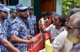 Protesters confront police as the parliament passed the contentious defamation bill on Tuesday. MIHAARU PHOTO/NISHAN ALI
