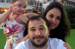 Alleged Russian hacker Roman Seleznev pictured with his girlfriend and daughter.