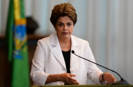 The final phase of the impeachment process against Rousseff will begin in the Brazilian senate on August 25. / AFP PHOTO / ANDRESSA ANHOLETE