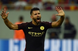 Manchester City's Argentinian striker Sergio Aguero celebrates scoring a goal during the UEFA Champions league first leg play-off football match between Steaua Bucharest and Manchester City at the National Arena stadium in Bucharest on August 16, 2016. / AFP PHOTO / DANIEL MIHAILESCU