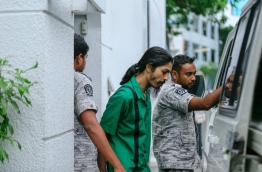 Prison officials leading Murrath away after a Supreme Court hearing. MIHAARU FILE PHOTO/MOHAMED SHARUHAAN